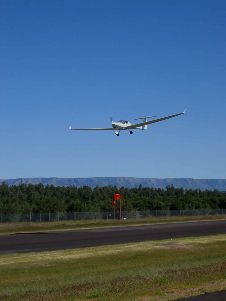 motorglider over Payson Airport runway