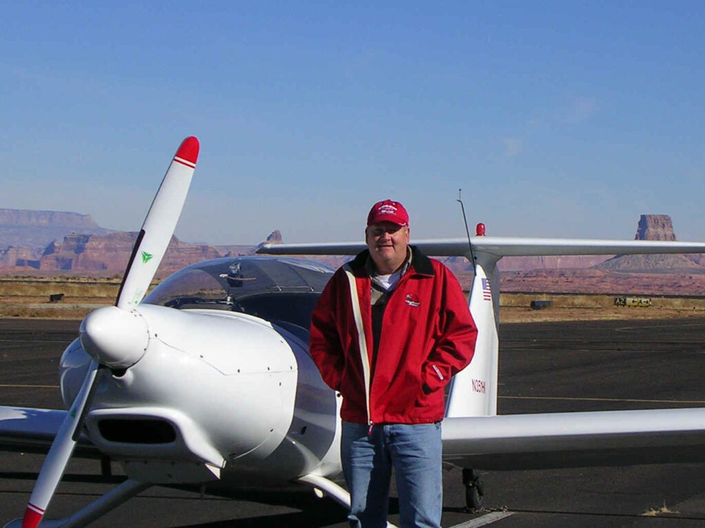 Russ Hustead with motor glider at Page AZ