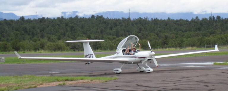 happy guys in motor glider at Payson airport