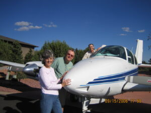 Lynn, Russ & Dan standing with motor glider