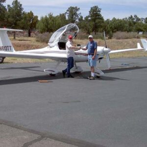 Runn & Jens shaking hands in front of motor glider
