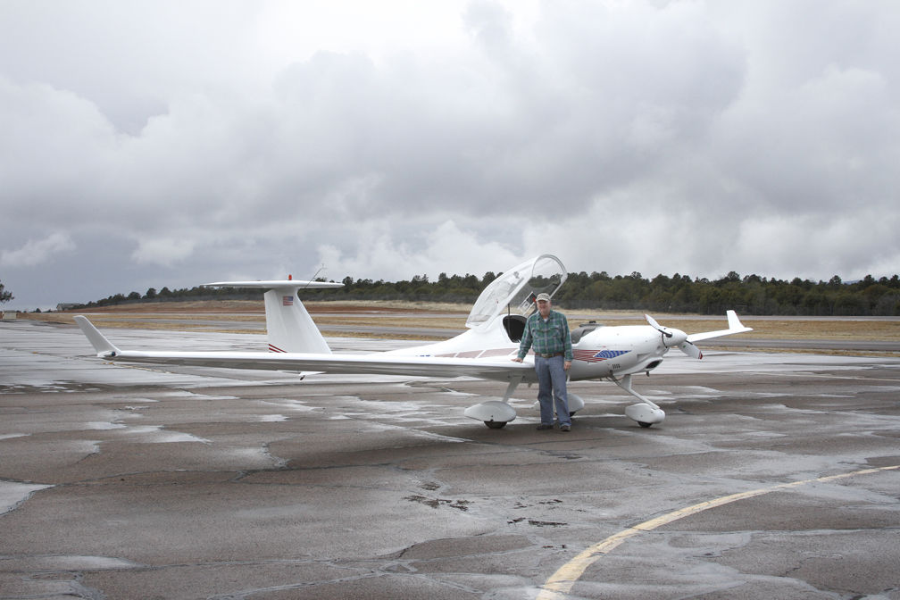 Russ Hustead with motor glider at Payson airport